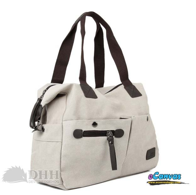 "62.32. Reference.   ""This large canvas messenger hand bag manages to..."